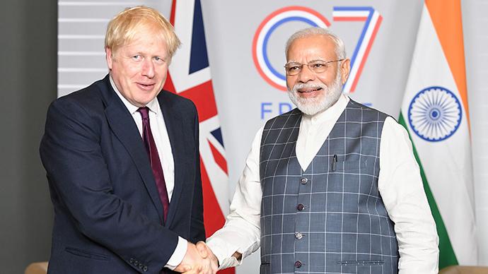 英国首相约翰逊与印度总理莫迪。人民视觉 资料图